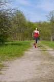 Jogging young athletic woman Royalty Free Stock Image