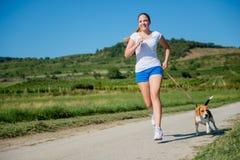 Jogging z zwierzęcym przyjacielem Zdjęcia Royalty Free