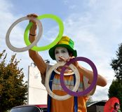 Joggling clown artist in Italy Stock Photo