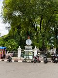 JOGJA, INDONESIA - AUGUST 12, 2O17: Close up of some motorcycles parked in the street, around a poor city urban house in Royalty Free Stock Photos