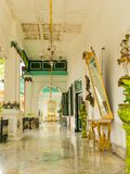 JOGJA, INDONESIA - AUGUST 12, 2O17: Indoor view of a glamorous hall with golden glasses and some white elegant lamp Stock Photo