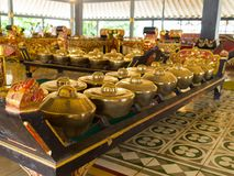 JOGJA, INDONESIA - AUGUST 12, 2O17: Indoor view of a golden pots acomodated in a row inside of a building at Taman Sari Royalty Free Stock Photography