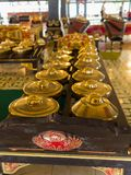 JOGJA, INDONESIA - AUGUST 12, 2O17: Indoor view of a golden pots acomodated in a row inside of a building at Taman Sari Stock Image