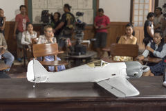 Jogjakarta, Indonesia - March 8, 2016: The crew prepares the scene with airplane during  shooting of the movie Rudy Habibie on Mar Royalty Free Stock Photo