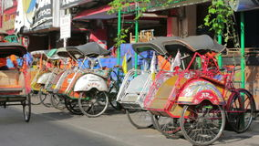 JOGJAKARTA - MAY 2012: transportation with cyclo stock video