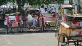 JOGJAKARTA - MAY 2012: transportation with cyclo stock footage