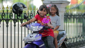 JOGJAKARTA - MAY 2012: two local kid on motorbike stock video