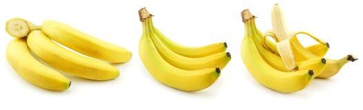 Jogo das bananas amarelas maduras isoladas no branco Fotos de Stock