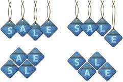 Jogo das etiquetas da compra da venda feitas das calças de brim ilustração stock