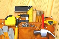 Jogo das ferramentas na correia Foto de Stock