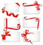 Jogo de cartões bonitos com curvas vermelhas do presente Fotografia de Stock