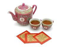 Jogo de chá chinês da longevidade e pacotes vermelhos Fotografia de Stock Royalty Free