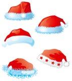 Jogo de chapéus de Santa Imagens de Stock