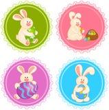Jogo de coelhos de Easter com ovos coloridos Imagens de Stock