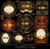 Jogo de etiquetas preto-douradas Imagem de Stock Royalty Free