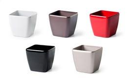 Jogo de flowerpots plásticos para plantas internas Foto de Stock Royalty Free