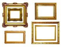 Jogo de frames dourados. Isolado sobre o branco Fotografia de Stock