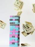 Jogo de Jenga com dinheiro fotografia de stock