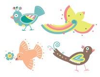 Jogo de quatro pássaros decorativos Fotografia de Stock Royalty Free