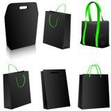 Jogo de sacos de compra pretos. Imagens de Stock