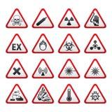 Jogo de sinais de perigo de advertência triangulares Fotografia de Stock Royalty Free