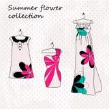 Jogo de três vestidos nas flores Imagem de Stock Royalty Free