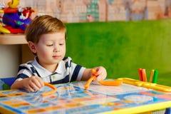 Jogo do rapaz pequeno Foto de Stock Royalty Free