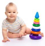 Jogo do rapaz pequeno com brinquedos Imagem de Stock Royalty Free