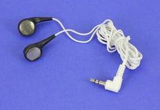Jogo dos botões da orelha no fundo azul Fotos de Stock