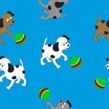 Jogo dos cães pequenos com a bola Fotos de Stock