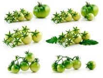 Jogo dos tomates amarelos e verdes maduros isolados Fotos de Stock Royalty Free