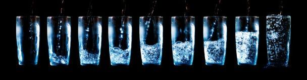 Jogo dos vidros com água e gelo Fotografia de Stock