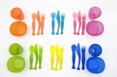 Jogo plástico dos mercadorias do prato fotos de stock royalty free