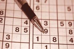 Jogo Sudoku e pena de esferográfica Imagens de Stock Royalty Free