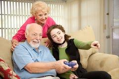 Jogo video da família imagens de stock