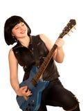 Jogos da mulher nova em uma guitarra Fotografia de Stock Royalty Free