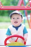 Jogos do bebê no campo de jogos fora Fotografia de Stock Royalty Free
