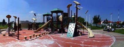 Jogos do campo de jogos em um parque Fotos de Stock Royalty Free