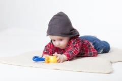 Jogos do menino com brinquedos Foto de Stock Royalty Free