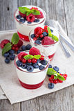 Jogurt and jelly dessert with berries. In small glasses stock photography