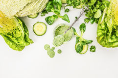 Jogurt smoothie with green vegetables , food background. Top view, frame stock photo