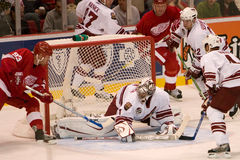 Johan Franzen Tries to Stuff One In On Curtis Joseph Stock Images