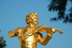 Johann Strauss playing violin. Johann Strauss golden statue in Vienna city park (Stadtpark Stock Images