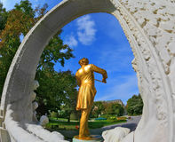 The Johann Strauss, playing the violin. Elegant gilded statue of Johann Strauss, playing the violin in white marble arch. Park in Vienna Royalty Free Stock Photo