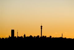 Johannesburg city skyline. Scenic view of Johannesburg city skyline silhouetted with sunset background Stock Images