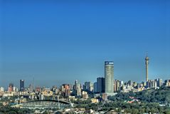 Johannesburg City skyline. Scenic view of Johannesburg City skyline with sport stadium in foreground Royalty Free Stock Images