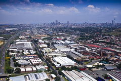 Johannesburg East with CBD in Background. Aerial view of the eastern industrial suburbs adjacent to the CBD Royalty Free Stock Photos