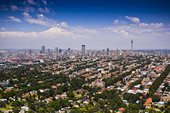 Johannesburg East with CBD in Background. Aerial view of the eastern residential suburbs adjacent to the CBD Royalty Free Stock Image