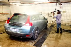 African Man washing a car at a underground carwash. Johannesburg, South Africa - April 27 2011: African Man washing a car at a underground carwash royalty free stock images