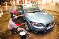 African Man washing a car at a underground carwash. Johannesburg, South Africa - April 27 2011: African Man washing a car at a underground carwash royalty free stock photography